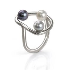 A ring to be notice with three freshwater pearls. The pearls sits in the interior top part of the ring which give the illusion of floating saucers. white, gray and purple pearls