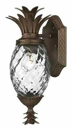 Here's a porch light that doesn't look like all the other porch lights in your neighborhood. This pineapple fixture from Hinkley Lighting's Plantation line is adorned with a solid brass finial sculpted to look like a pineapple tuft.