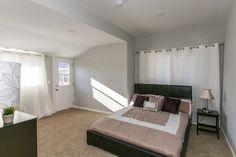 Master bedroom with tan plush carpeting, white curtains, sunny throughout.  #RealEstate #Homes #HouseFlip #Sunland #Tujunga #California  www.verono.com/nassau