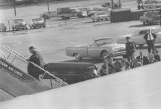 President <b>Kennedy</b>'s <b>casket</b> was being put on the plane.