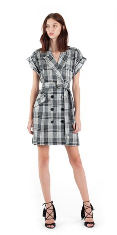 It's clear that opposites attract in this rock and roll plaid print dress with a classic silhouette. - Notch collar - Rolled sleeves - Double-breasted button cl