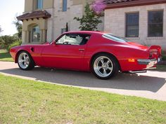 1973 Pontiac Trans Am Buccaneer Red with polished American Racing Torq Thrust II wheels