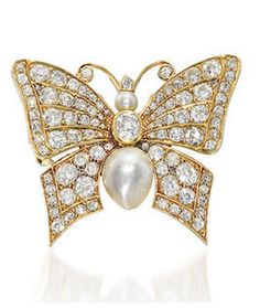 A natural pearl and diamond novelty brooch, circa 1900 The butterfly set with an oval-cut diamond and a baroque natural pearl, completed by oval and old brilliant-cut diamonds, accented with a smaller pearl, diamonds approximately 3.80 carats total, length 3.8cm