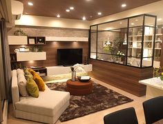 リビングルーム – アトリエのあるリビングコーディネート|各空間を見渡せるリビング。 家族各々の時間を楽しみつつも、すぐそばに家族の気配を感じられる温かい空間です。