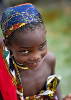 Smiling one eyed Mucubal girl - Angola by Eric Lafforgue, via Flickr