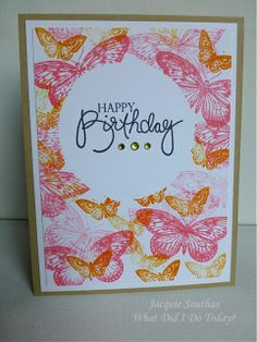 handmade birthday card from what did I do today? ... one layer card ... bright and colorful ... sentiment in masked circle space ... butterflies in pinks and oranges stamped and over stamed ... luscious colors  ...