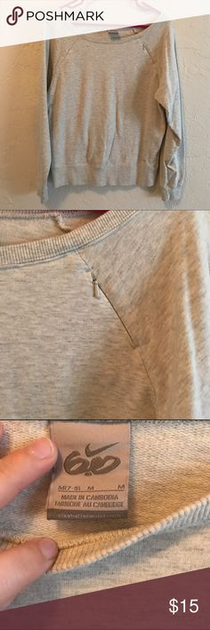 Nike Off the Shoulder Sweatshirt Basic off the shoulder sweatshirt by Nike. It's very warm! There is a small zipper pocket on one of the front shoulders. Great condition! Nike Tops Sweatshirts & Hoodies