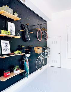 9 Expert Tips For Creating A Clutter-Free Home Opt for vertical storage. Opt for vertical storage. Photographer: Daniel Hennessy Opt for vertical storage. Bike Storage Apartment, Gym Room At Home, Clutter Free Home, Garage Makeover, Garage Renovation, Garage Remodel, Vertical Storage, Boutique Interior, Boutique Design
