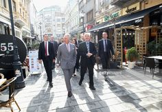 Prince Charles, Prince of Wales (L) during a walking tour of the Old Town on the third day of his nine day European tour on March 31, 2017 in Bucharest, Romania. (Photo by Chris Jackson - WPA Pool/Getty Images)