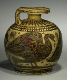 CORINTHIAN POTTERY ARYBALLOS  Spherical in form with a siren, her wings spread, and two birds; rosettes in the field.  Ca. 600 BC