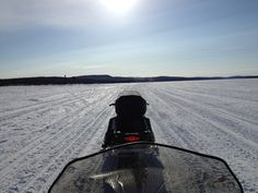 The view down the river from my snow mobile.  James' snow mobile in front.