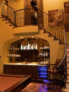 This is a game room staircase looking up to a mid-level Media Room (the pocket doors at the landing) with a small wet bar under the staircase
