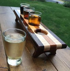 Handcrafted Wooden Beer Flight (4 Glasses) by ConwayCraftings on Etsy https://www.etsy.com/listing/243507398/handcrafted-wooden-beer-flight-4-glasses