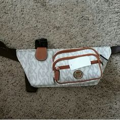 MK Insp. Fanny Pack Belt Purse NWT Brand-new! Michael Kors inspired fancy fanny pack. Includes a compartment for cell phone, credit card slots, great for hands-free, purse free activity. Bags Mini Bags