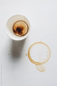 Empty coffee cup with coffee ring stain by Kristin Duvall #stocksy #realstock