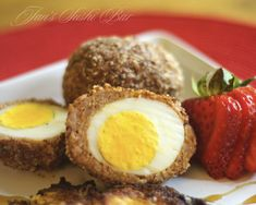 Scotch Eggs -- Hard boiled eggs wrapped in breakfast sausage, & dipped in almond meal for that signature crunch.