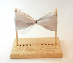 DIY Ask Dad to make me one of these bow maker blocks.very simple to take a block of wood, drill some holes & cut down a wooden dowel Diy Ribbon, Wired Ribbon, Ribbon Crafts, Ribbon Bows, Ribbons, Christmas Bows, Christmas Crafts, Ribbon Retreat, Decorative Bows