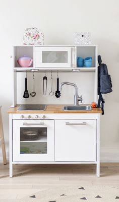IKEA DUKTIG play kitchen hack - paint all white, add butcher block contact paper + add new hardware