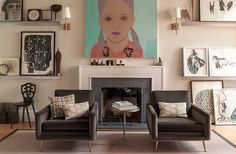 Light beige walls with contemporary art work equals fab!