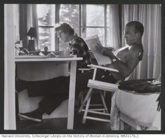 Julia and Paul Child seated indoors reading at a table, Lopaus, Maine, ca.1960. © The Julia Child Foundation for Gastronomy and the Culinary Arts