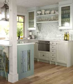 Sarah Richardson designs  use this blue island color with reclaimed wood top!!