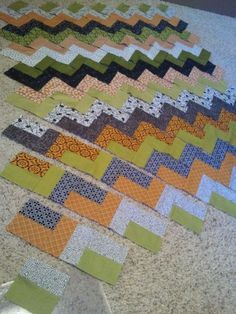 Now this one I could do. These are not my colors, but, this Chevron Quilt Tutorial is SO CLEVER -- it's all strips with straight seams! Very easy pattern / method from The Little Fabric Blog..