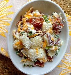 3-lb. bag red potatoes      1-1½ cups sour cream, (reduced fat is fine)      ½-¾ cup mayonnaise, (light is fine)      1-2 packages ranch seasoning mix      1 ½ cups grated sharp cheddar cheese      5 green onions, chopped      10-12-oz. package thick-cut bacon, cooked  crumbled