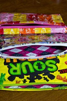 I found this and it looked so easy that I had to try it right away. Guess what, It WAS super easy! Materials you'll need: Candy wrappers/candy bag Scissors Duct tape (any color/pattern you&#8…
