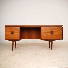 IB Kofod-Larsen; Teak and Rosewood desk for G-Plan, 1960s.