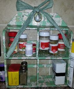 An old rack decoupaged and now used as a spice rack in my kitchen!