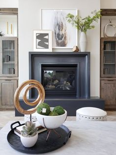 Using greenery, accessories, and layered art on your mantel for perfect fireplace style. Hang one piece of art and have the other leaning fo a laid back design look. Black fireplace design creates statement in neutral living room. Decor, Modern Fireplace Mantles, Wood Fireplace, Stone Fireplace Mantel, House Styles, Mantle Decor, Home Decor, Fireplace Mantels, Modern Fireplace