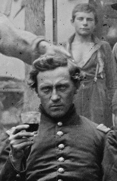 Captain Nathan J. Johnson. Drum Major (and later 2nd Lt) Patrick Ford in the background. 93rd New York Infantry.If you click on the image,there is a discussion of the photo,which certainly answered my questions about this intriguing image.