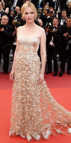 Kirsten Dunst ended her style streak at the 69th Cannes Film Festival in spectacular fashion, hitting the red carpet in an exquisite nude floral-embroidered lace Valentino Haute Couture creation with pink Chopard diamonds.
