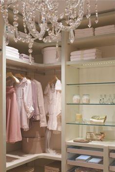 Gorgeous Closet...love the glass shelves & chandelier.
