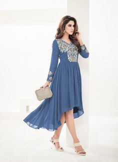 Buy kurti online from our collection of exclusive indian kurti. Grab this sonorous faux georgette blue party wear kurti. Party Wear Kurtis, Kurti Designs Party Wear, Party Fashion, Fashion Wear, Fashion Dresses, Stylish Kurtis, Embroidered Kurti, Indian Party Wear, Party Tops