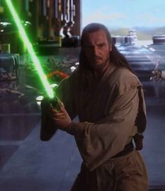 Qui-Gon Jinn. He was representing us hippie gentleman a long, long time ago, in a galaxy far away... Before it was cool! His long hair is as soft and shiny as a Garnier Fructis commercial, don't ya' think?