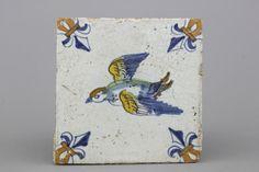 A polychrome Dutch Delft tile with a bird, 17th C.