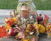 Rustic Fall Autumn Centerpiece mason jar candle floral grapevine ring fall wedding moss green pale yellow brown pods pinecones flowers