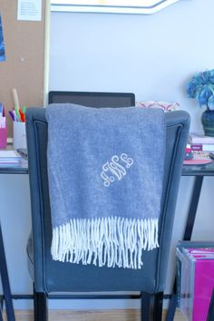 Get cozy in the office with a personalized Tiny Prints throw to drape over any chair for an elegant factor.
