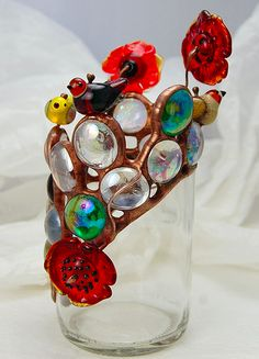 Louise Nelson, UK, Recycled bottle with copperfoil stained glass, fusing and lampworking. 2011 - found a shop in Geneva, there are glases like this! Cutting Glass Bottles, Recycled Glass Bottles, Bottle Cutting, Glass Bottle Crafts, Painted Wine Bottles, Bottle Art, Cut Bottles, Stained Glass Projects, Stained Glass Patterns