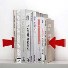 A metal sheet is hidden in the inside book cover and a magnet arrow holds the books up! Magic!