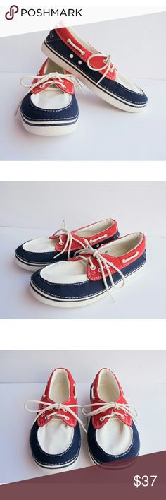 CROCS Women's Canvas Boat Shoes Size 9 This listing is for one pair of Red, White, & blue CROCS. They are in fantastic condition, and marked as a Women's Size 9. CROCS Shoes Flats & Loafers