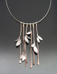 "Necklace | Aileen Lampman. ""Bamboo Forest"". Sterling silver cable with gold filled stalks of bamboo and sterling leaves"