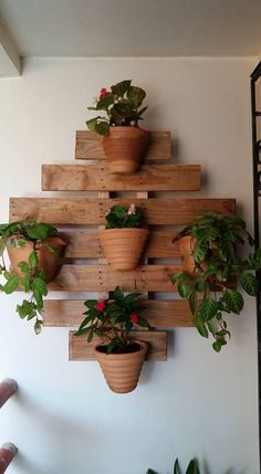 Pallet shelves aren't only good for storing paper and other lightweight items. They can actually be quite sturdy and. decoration house Top 10 Easy Woodworking Projects to Make and Sell House Plants Decor, Plant Decor, Porch Plants, Backyard Plants, Garden Projects, Wood Projects, Easy Projects, Garden Ideas, Backyard Ideas