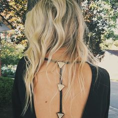 Beachy waves and an open back top.