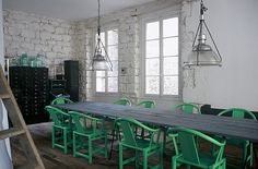 glass specamin jars, industrial lamps, nice jade chairs, black cabinets, exposed painted brick walls... this is almost perfect!