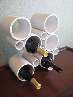 pvc wine holder. I could make this (seeing as I'm a plumber) with bigger pipe and use for shoe, saddles, mitts and gloves