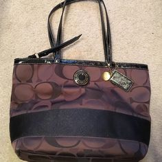Coach purse - brown black and pink Cute Coach purse. Brown and black on exterior. Interior of purse is pink. Lots of life left in this purse Coach Bags Shoulder Bags