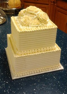 Not crazy about the color, but this gives me an idea of what buttercream icing would look like, as opposed to fondant