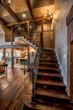 Lake Cottage Style: beautiful staircase with dark walnut wood and black iron stair rails/banister.